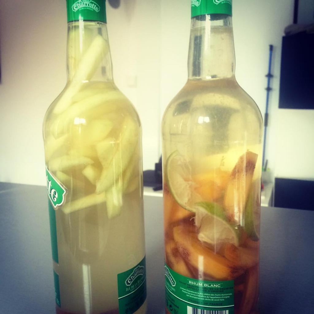 Two bottles of arranged rum, khaki and lime and ginger